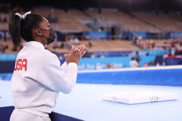 Simone Biles cheers for her teammates during the Women's Team Final on day four of the Tokyo 2020 Olympic Games at Ariake Gymnastics Centre on July 27, 2021 in Tokyo, Japan. (Photo by Laurence Griffiths/Getty Images)