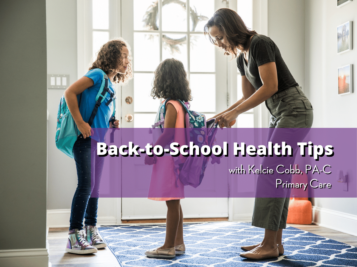 Mother helps two young children with their backpacks, text on image reads Back to School Health Tips with Kelcie Cobb, PA-C, Primary Care
